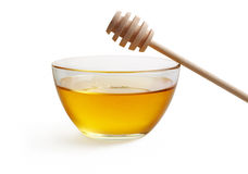 Honey in glass bowl Stock Photography