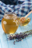 Honey in a glass bowl, not painted wooden planks background Royalty Free Stock Photography