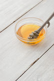 Honey in the glass bowl  on the white wooden  table  vertical Stock Photos