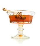 Honey in a glass dish Stock Photos