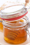 Honey Glass with Honeycomb Royalty Free Stock Images