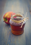 Honey in glass jar and apple Stock Image