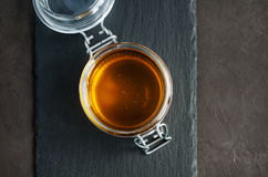Honey in a glass jar Stock Images