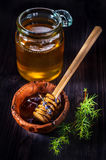 Honey in a glass jar and in a bowl Stock Photo