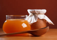 Honey in a glass jar Royalty Free Stock Photography