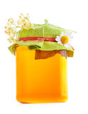 Honey in glass jar with flowers Stock Photos
