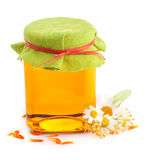 Honey in glass jar with flowers Stock Image