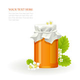 Honey in glass jar and flowers Royalty Free Stock Images
