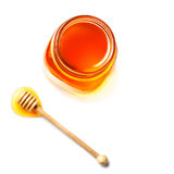 Honey in a glass jar with honey dipper isolated on white backgro Stock Image