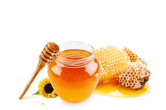 Honey in glass jar and honeycombs wax Royalty Free Stock Images