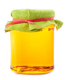 Honey in glass jar isolated on white background Stock Photography