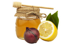 Honey in glass jar lemon onion Stock Photos
