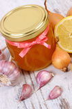Honey in glass jar, onion, lemon and garlic, healthy nutrition and strengthening immunity Stock Photos