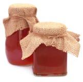 Honey in glass jar Stock Image