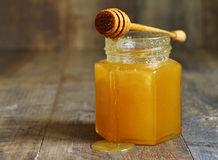 Honey in a glass jar. Stock Photo