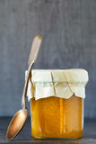 Honey in a glass jar Stock Image