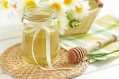 Honey. In a glass jar and stick Stock Image
