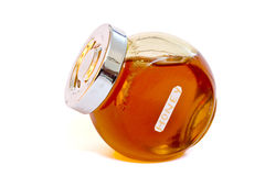 Honey. Glass jar of honey  on white, with clipping path Royalty Free Stock Photography