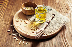 Honey in a glass jar with wooden dipper Royalty Free Stock Photos