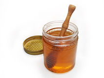 HONEY GLASS JAR WITH WOODEN DRIZZLER Stock Photos