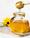 Honey in glass jars Royalty Free Stock Image