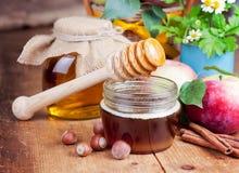 Honey in glass jars Royalty Free Stock Photo