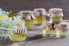 Honey in a glass jars, wild flowers Stock Photography