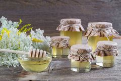 Honey in a glass jars, wild flowers Royalty Free Stock Photo