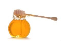 Honey in glass pot with stick Stock Photography