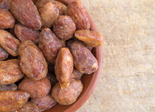 Honey glazed almonds in a small bowl. Royalty Free Stock Photos