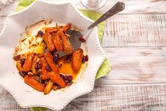 Honey Glazed Baby Carrots With Cranberry, Thyme and Nuts Stock Photos