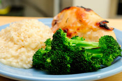 Honey glazed bbq chicken breast with creamy risotto Royalty Free Stock Photo