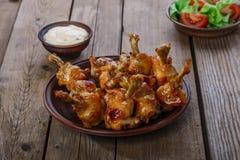Honey glazed chicken wing Stock Photos