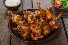Honey glazed chicken wing Stock Photography