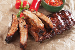 Honey glazed pork ribs. Oven roasted pork ribs marinated in barbecue sauce and glazed in honey stock images