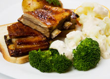 Honey glazed ribs with broccoli and cauliflower Royalty Free Stock Photography