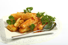 Honey glazed roast parsnips Royalty Free Stock Image