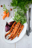 Honey glazed roasted carrots with chopped almonds Stock Photography