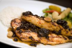 Honey glazed roasted chicken breast with dried fru Stock Photography