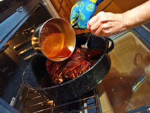 Honey Glazing the Ham Stock Photography
