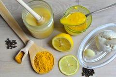 Honey Golden Turmeric. Natural antibiotic with honey Golden Turmeric Stock Photography