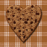 Honey Heart Cookie. Illustration of a chocolate chip cookie on a plaid tablecloth Stock Image