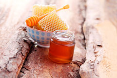 Honey with honey comb Royalty Free Stock Photos