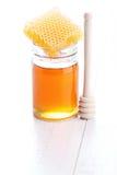 Honey with honey comb Stock Image