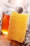 Honey with honey comb Stock Photos