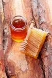 Honey with honey comb Royalty Free Stock Image