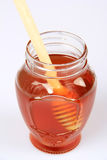 Honey and Honey Dipper Royalty Free Stock Images