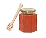Honey and honey dipper (honey stick) Royalty Free Stock Images