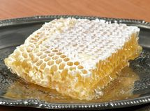 Honey in honeycomb. Close-up on tray Stock Photo