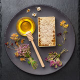 Honey, honeycomb and dried herbs stock image